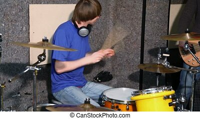 drummer playing on dums in recording studio - drummer...