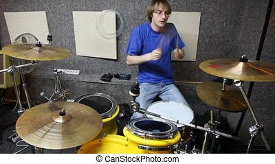 drummer playing on dums in studio