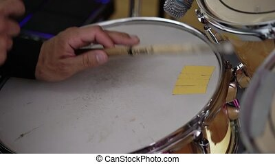 Drummer playing percussion on concert shot