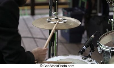 Drummer playing percussion outdoors