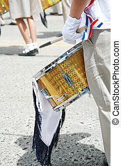 Drummer playing snare drums in parade, copy space, vertical