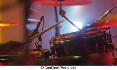 drummer playing the drums at a concert close up.