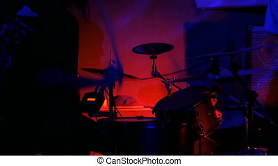Drummer playing the drums - Unrecognizable male drummer...