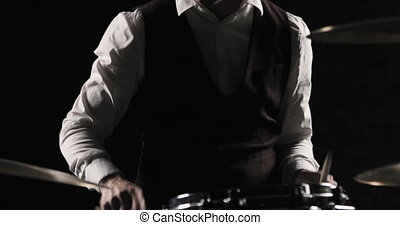 Drummer Plays Drums Kit. Drummer Hand Silhouette With Drumstick. Close up of Drummer Hand Playing Drum Plate on Rock Concert. Rock Band Performing on Stage