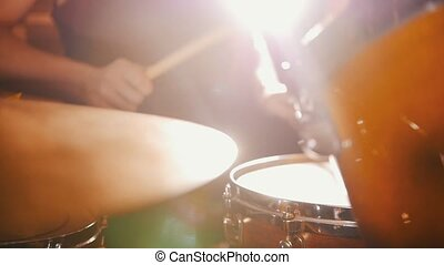 Drummer plays music in studio in a garage. Slow motion