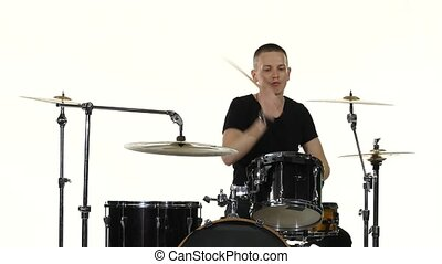 Drummer plays vigorous music on a drum set. White background