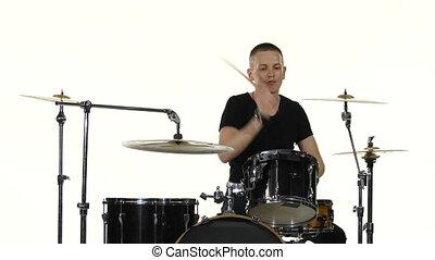 Drummer plays vigorous music on a drum set. White background