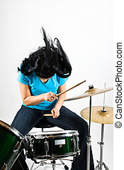 Drummer woman flipping hair feeling the music and play drum...