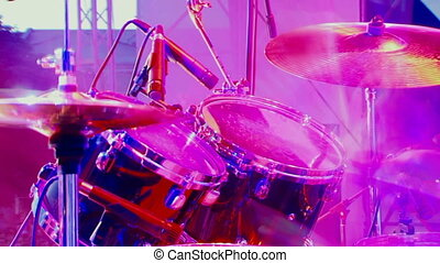 Drummer - Colorful. Blurred. Man plays the drums.