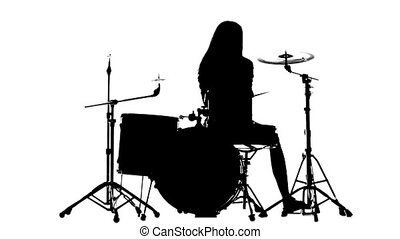 Drummer vigorously plays the drums, her wand. White background. Silhouette. Slow motion
