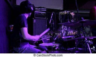 Drummer with headphones