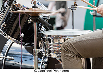 Drummer - Young man playing the drums on street performance