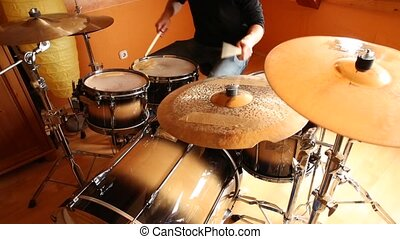 Drumming - A drummer performing on his Drumset.