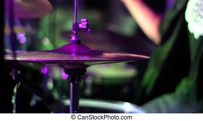 drumming in colored lights. metal concert. c - drumming in...