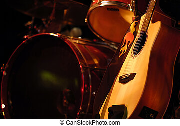 Drums and Guitar - Drums and acoustic guitar in subdued...