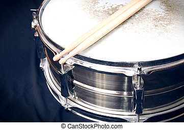Drums conceptual image. Snare drum and stick over black...