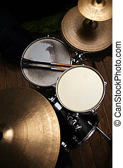 drum set in dramatic light on a black background