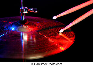 drums set in blue and red colours light on black background