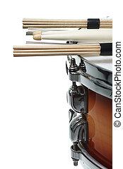Drumsticks resting on a snare drum - Drumsticks and...