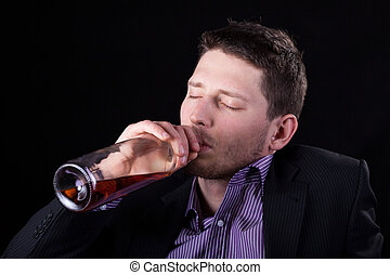Drunk businessman drinking wine