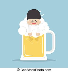 Drunk businessman in beer mug