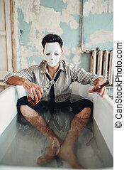 Drunk businessman sitting in bathtub, suicide man