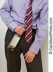 Drunk businessman with a bottle