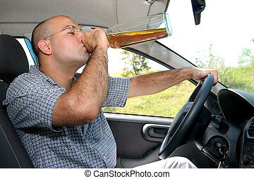 Drunk driver - Drunk man sitting in drivers sit and drinking...