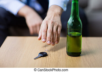drunk driver hand taking car key from table
