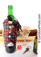 bottle dressed in jacket warmer with keys as arms on white background depicting drunk driving