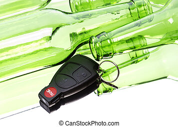 Drunk driving - Car key and bunch of empty glass beer...