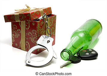 Car keys, beer bottle and a present of handcuffs.