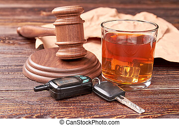 Drunk driving concept. Driving keys, gavel, glass of whisky...