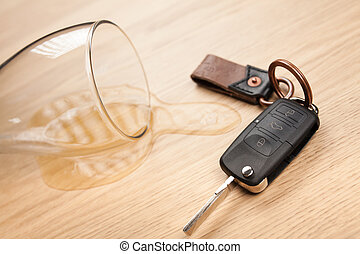Drunk driving concept - spilled beer and car keys on a table