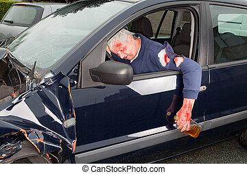 Drunk driving - Drunken driver hanging out of his crashed...