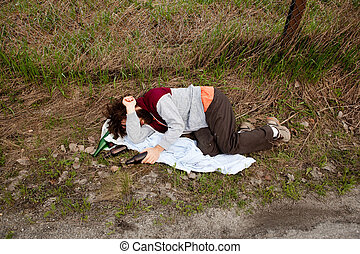 Drunk in the Ditch - A drunk laying in the ditch with a...