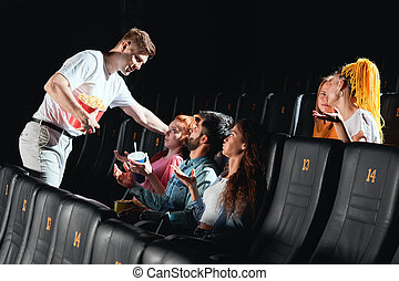 drunk man holding popcorn and flirting with ginger girl