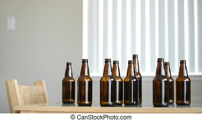 Drunk man looks for more beer in empty bottles