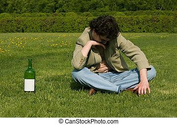 Drunk man on a meadow