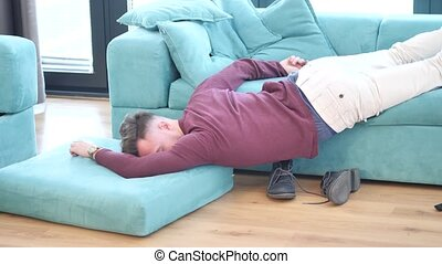 Drunk Man Resting on Couch with head on the Floor - Drunk...
