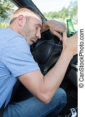 drunk man sleepy in the car