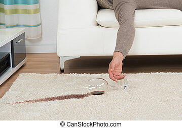 Drunk Man Spilling Red Wine On Rug - Cropped hand of drunk...