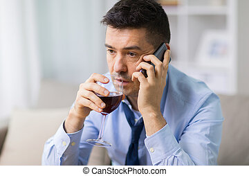 drunk man with alcohol calling on smartphone
