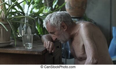 Drunk old man sleeping at the table - Old depressed drunk...