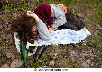 Drunk Passed Out - A drunk passed out in the ditch with a...
