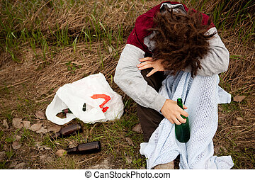 Drunk Person - A drunk person sitting in a ditch with a wine...