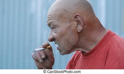 Drunk Smoking Eldery Man - Drunk homeless smoking man on the...