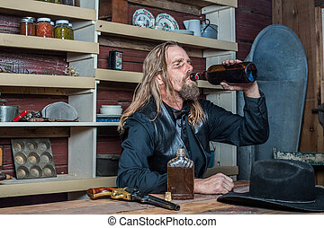 Drunk Western Man Looks Towards His Drink as he Sits at Table