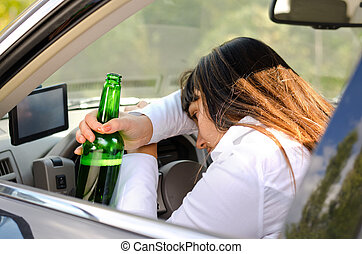 Drunk woman driver passed out in the car with her head...