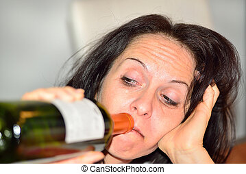 Drunk woman with red wine bottle